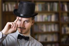 Attractive young man wearing top hat and bow tie Stock Photos