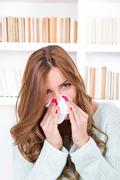 Beautiful girl feeling ill caught cold sniffles blowing her nose Stock Photos