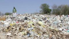 Symbolic shot environmental protection, man with gas mask on landfill, 25fps. - stock footage