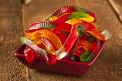 Colorful fruity gummy worm candy Stock Photos