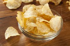 unhealthy crispy potato chips - stock photo