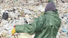 Symbolic shot environmental protection,man with gas mask on landfill,face 30.mp4 Stock Footage