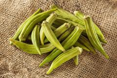 Organic green okra vegetable Stock Photos