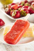 cold organic frozen strawberry fruit popsicle - stock photo