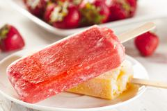 Stock Photo of cold organic frozen strawberry fruit popsicle