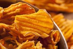 crispy orange sweet potato chips - stock photo