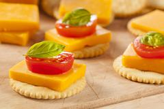 Chedder cheese and cracker appetizer Stock Photos