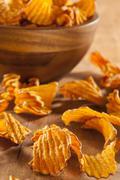 Crispy orange sweet potato chips Stock Photos