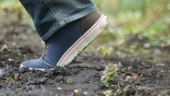 Walking Over lush Moist Soil Stock Footage