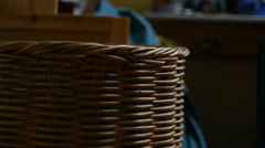 Dirty Clothes Thrown into Laundry Basket Stock Footage