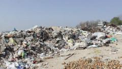 Garbage truck transports and disposes trash on the landfill, dump, 25fps. - stock footage