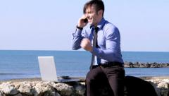 Handsome business man making great deal on the phone Stock Footage