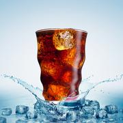 Glass with cola and ice Stock Photos