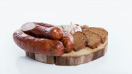 Stock Video Footage of Rural Easter breakfast with smoked sausage