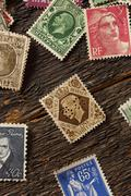 colorful vintage used postage stamps - stock photo