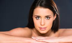 Stunning young beautiful woman close up portrait head shoulders Stock Photos