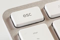 Escape button on a white and grey computer keyboard Stock Photos