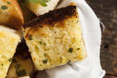 Homemade crunchy garlic bread Stock Photos