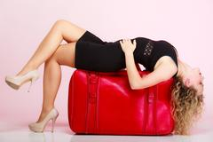 full length elegant lady in voyage, traveler woman with old red bag - stock photo