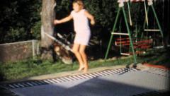 Teenage Girl On In Ground Trampoline-1967 Vintage 8mm film Stock Footage