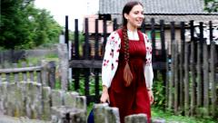 Happy girl in village Stock Footage