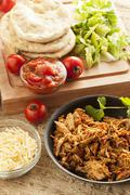 organic mexican shredded beef for tacos - stock photo