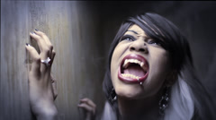 Female Vampire power scream (rocks the foundation) - stock footage