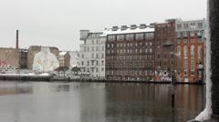 Berlin Kreuzberg - Spree river in winter - Street artist Blu in the background Stock Footage
