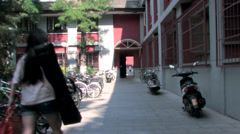 A student walking to her dormitory Stock Footage