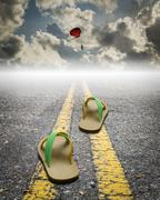 A pair of sandal on the road with parachute on the sky Piirros