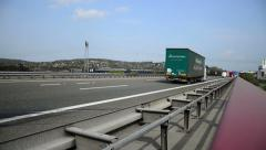 truck on german autobahn/highway driving away on a bridge - stock footage
