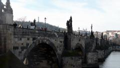 PRAGUE, CZECH REPUBLIC - MARCH 2014: Charles Bridge with people and Vltava river Stock Footage