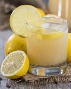 Fresh made lemon juice Stock Photos