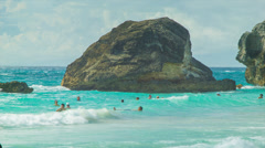 People Swimming Amongst Big Rocks at Horseshoe Bay, Bermuda Stock Footage