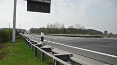 truck on german autobahn/highway driving away on a bridge - stock footage