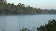 Mist and Fog moving across a lake at sunrise Stock Footage