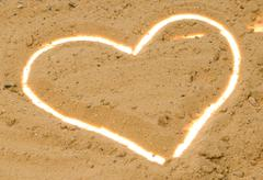 White contour heart in the sand Stock Photos