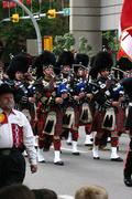 kilted bagpipe players - stock photo