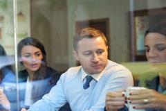 Businesspeople having break in cafe, steadycam shot. Stock Footage