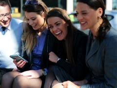 Businesspeople meeting on street bench, steadycam shot. Stock Footage