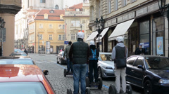 PRAGUE, CZECH REPUBLIC - MARCH 2014: Group of people riding on Segway in Prague Stock Footage