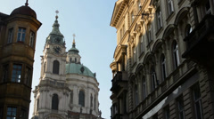 PRAGUE, CZECH REPUBLIC: St. Nicholas Church (Mala Strana) with other buildings Stock Footage