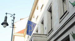 PRAGUE: European Union Flag hanging on the state building and security cameras Stock Footage