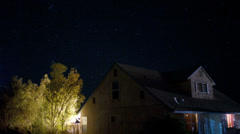 Stars spinning around a house timelapse Stock Footage
