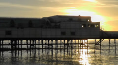 Sunset behind Aberystwyth pier, Wales Stock Footage