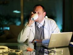 Doctor taking pills at night in office by the desk. Stock Footage