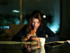 Woman texting message on cellphone at night in the table. Stock Footage