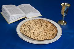 Passover Jewish holiday table with Hagada and matzo bread Stock Photos