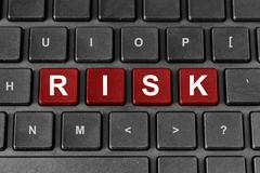 risk word on keyboard - stock photo