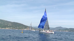 Sailing boat opening sails Stock Footage